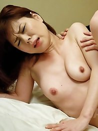 Yukari Asian with squeezed nipples waits for cum after doggy fuck