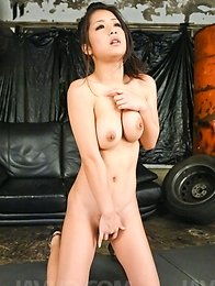 Satomi Suzuki Asian sucks tow dicks and plays with her boobies