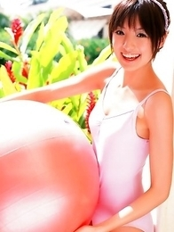 Akina Minami in colorful bath suits plays with big ball