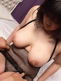 Chihiro Manaka licks nipples of her huge tits and rubs dick with